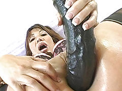 Ava fucks her mature ass with a huge black dong