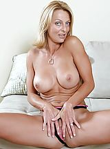 Milf Pics: Bare skinned Brenda James spreads her pussy lips before drilling her juice box with a stiff dildo