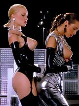 Suze Randall Pics: Alicyn Sterling and Mona in one of Suze's finest Classic Fetish shoots.
