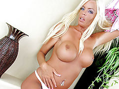 Stunners, Tanned blonde removes her dress exposing her huge tits