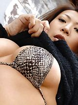 Shaved Pussy, Asian model Jun likes to show off her ass
