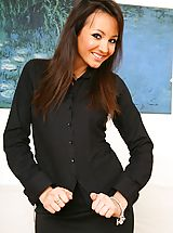 Pantyhose Babes: Gorgeous brunette Rachael B in a sexy black secretary outfit and patterned pantyhose.