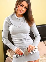 Secretary Pussy: Stunning Bryoni-Kate relaxes on her bed in a sexy tight grey top with black stockings.