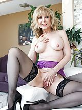 Erotic Babe, Bill Bailey, Nina Hartley Sizzling Woman reveals her naked juggs, pulls down her panties and opens her legs and hand fucks her tight cunt