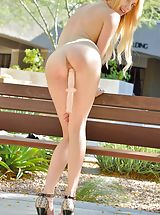 Sexy Bitch Blake Outdoor Sexuality shows her naked tits, draws down her lingerie and spreads her legs and stimulates her moist pussy