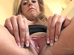 Jodie fingers her wet pussy
