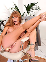 Anilos Pics: Darla Crane, Brunette Anilos Darla Crane stretches her mature pussy with a glass toy in the office