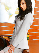 Only Tease Pics: Beautiful brunette secretary Laura A strips from her cute grey suit and purple shirt to give us a glimpse of her sexy white lingerie Non Nude