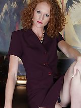 Milf Babes: Small bosomed curly redhead Ande exposes her older slit.