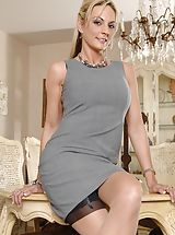 Hot Babes, Curvy golden-haired MILF Sindy Lange opens her pink slit lips.