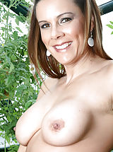 Brunette Anilos Victoria loves to expose her experienced shaved pussy while she hangs out in her garden