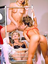 Suze Randall Pics: Bored babes Dionna, Renee, and Sara St. James hang loose in the laundromat.