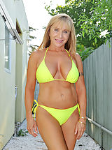 Busty milf Luna wears a bikini and gives a peek of her sizzling hot mature frame as she chills by the pool