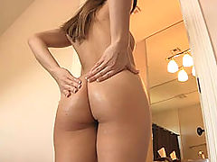 Dani gives herself a hard breast and ass massage