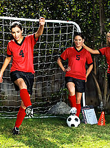Outdoors Pussy: Three sexy girls warm up on the soccer field before taking advantage of the coaches hard dick.