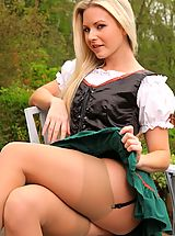 Stocking Babes: Jana D looks sexy, outside in her skimpy fraulein outfit.