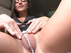 Bald Pussy, Melissa sits in a car with a sweet camel toe with pearls