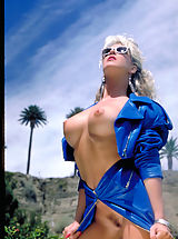 Suze Randall Pics: One of the sexiest pornstars from the '80's Angela Baron shows off her sizzling curves poolside!
