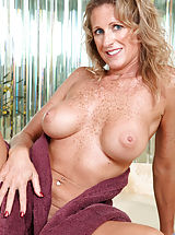 Milf Babes: Seductive Anilos Jade gets wet in the tub and fondles her pink juice box